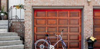 How much o replace garage door torsion spring?